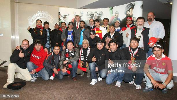 David Gill of Manchester United poses with 23 of the freed Chilean miners at a Farewell Reception at Old Trafford on December 14, 2010 in Manchester,...