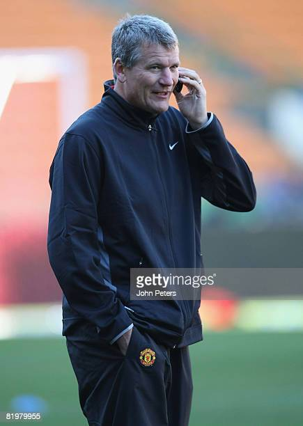 David Gill of Manchester United talks on his mobile phone during a first team training session during their preseason tour to South Africa at...