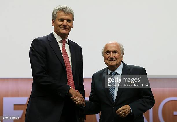 David Gill poses with FIFA President Joseph S. Blatter after becoming FIFA Vice-President during the 65th FIFA Congress at the Hallenstadion on May...