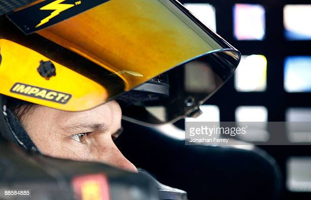 David Gilliland driver of the Adobe Road Winery Chevrolet sits in his car during practice for the NASCAR Sprint Cup Series Toyota/Save Mart 350 at...