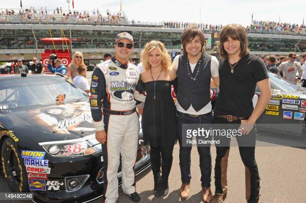 David Gilliland driver of the Big Machine Records Ford and Kimberly Perry Neil Perry and Reid Perry of The Band Perry attend the Brickyard 400...