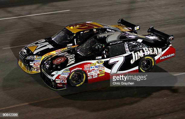 David Gilliland driver of the Jim Beam Toyota races Jeff Burton driver of the Caterpillar Chevrolet during the NASCAR Sprint Cup Series Chevy Rock...