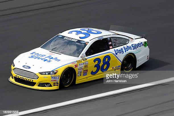 David Gilliland driver of the Long John Silver's Ford during practice for the NASCAR Sprint Cup Series CocaCola 600 at Charlotte Motor Speedway on...
