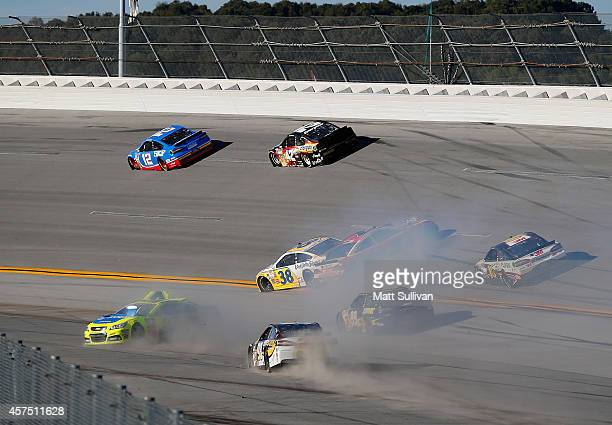 David Gilliland driver of the Long John Silver's Ford Michael Annett driver of the Golden Corral Chevrolet Josh Wise driver of the Dogecoin/Redditcom...