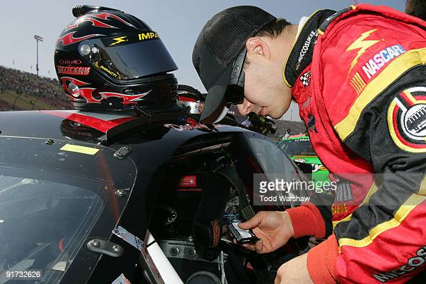 David Gilliland driver of the Miccosukee Chevrolet prepares to drive before the NASCAR Nationwide Series Copart 300 at Auto Club Speedway on October...