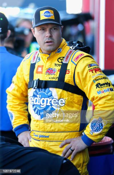David Gilliland driver of the Pedigree Toyota stands in the garage area during practice for the NASCAR Camping World Truck Series Fr8Auctions 250 at...