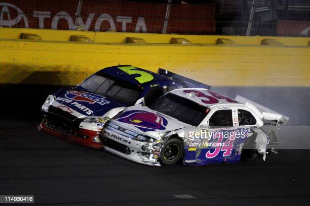 David Gilliland driver of the Taco Bell Ford and Mark Martin driver of the Carquest/GoDaddycom Chevrolet collide after hitting the wall during the...