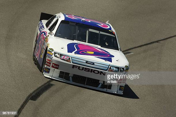 David Gilliland driver of the Taco Bell Ford drives during practice for for the NASCAR Sprint Cup Series Crown Royal Presents the Heath Calhoun 400...