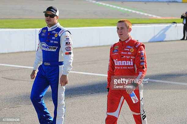 David Gilliland, driver of the The Pete Store Ford, and Cole Whitt, driver of the Front Row Motorsports Ford, during qualifying for the NASCAR Sprint...