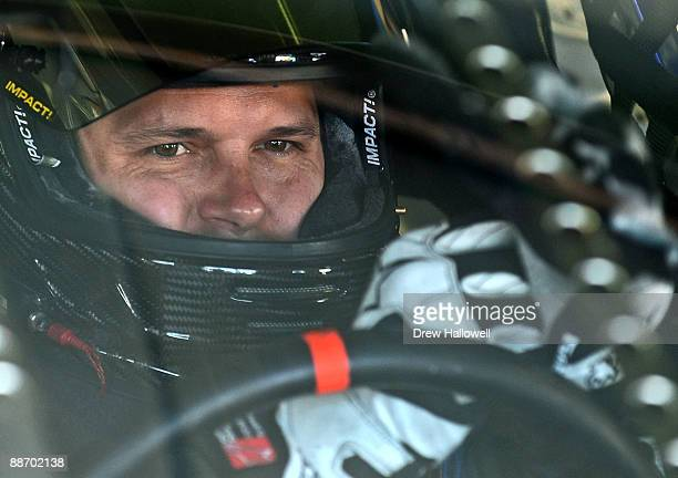 David Gilliland driver of the TRG Motorsports Chevrolet sits in his car during practice for the NASCAR Sprint Cup Series LENOX Industrial Tools 301...