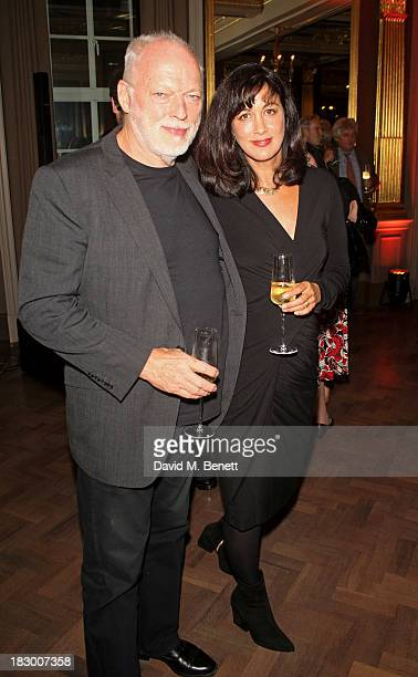 David Gilmour and Polly Samson attend the launch of Geordie Greig's new book Breakfast With Lucian on October 3 2013 in London England