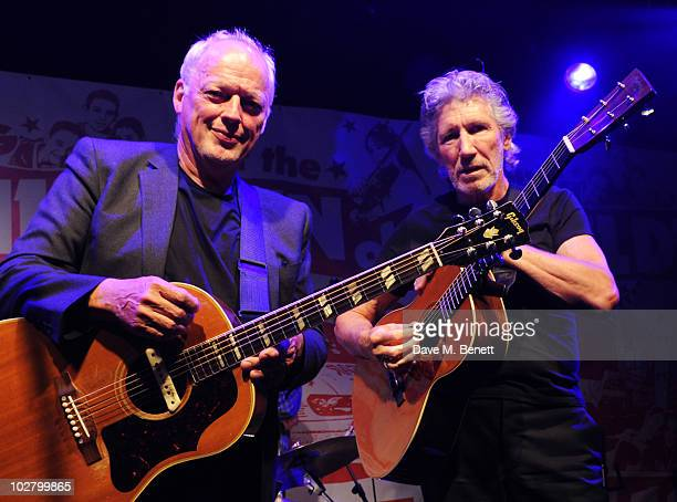 David Gilmour and Roger Waters perform at a benefit evening for The Hoping Foundation on July 10, 2010 in London, England.