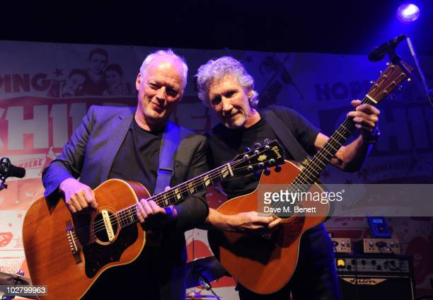 David Gilmour and Roger Waters perform at a benefit evening for The Hoping Foundation on July 10 2010 in London England