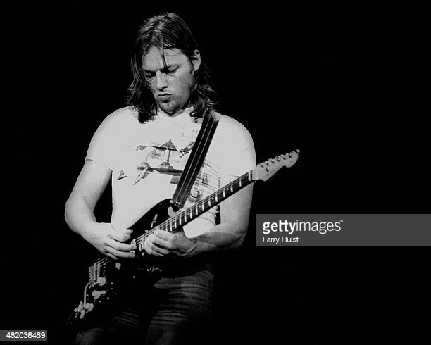 David Gilmour is performing with 'Pink Floyd' at the Oakland Coliseum in Oakland, California on May 9, 1977. (Photo by Larry Hulst/Michael Ochs...