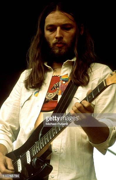 David Gilmour of Pink Floyd performs on stage at Hyde Park, London, 31st August 1974.