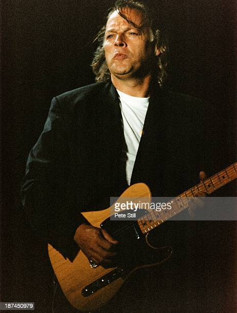 David Gilmour of Pink Floyd performs on stage at Knebworth '90, on June 30th, 1990 in Knebworth, Hertfordshire, England.