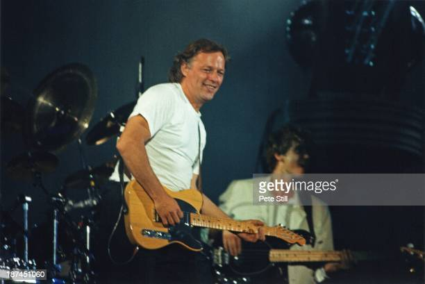 David Gilmour of Pink Floyd performs on stage at Wembley Stadium on August 5th 1988 in London England