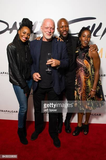 David Gilmour with his backing vocalists Lucita Jules Bryan Chambers and Louise Marshall arrive for the David Gilmour 'Live At Pompeii' premiere...