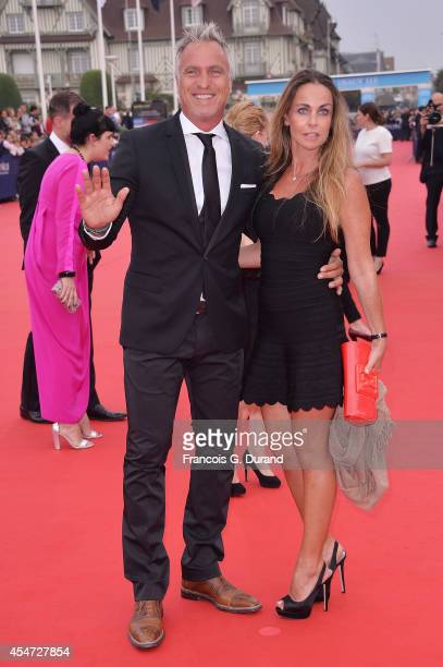 David Ginola and Coraline Ginola arrive at the opening ceremony of 40th Deauville American Film Festival on September 5 2014 in Deauville France