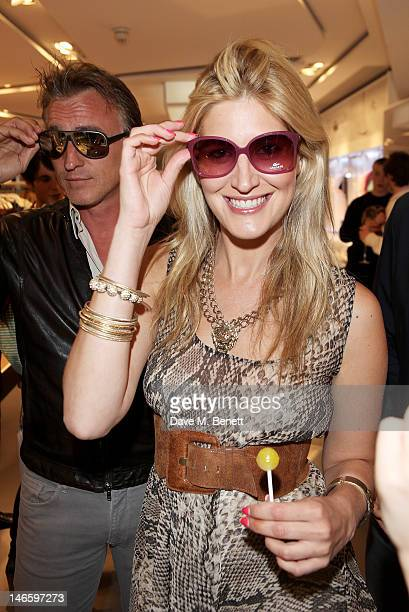 David Ginola and Francesca Hull try on sunglasses at the launch of Lacoste's new London Flagship store in Knightsbridge on June 20 2012 in London...