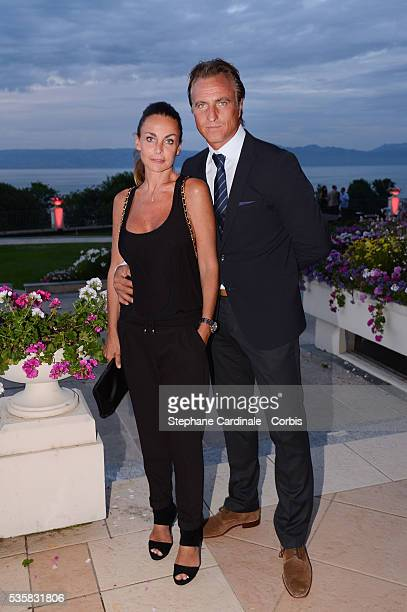 David Ginola and Wife Coraline attend the Lacoste Party during the Evian Masters 2012 in Evian