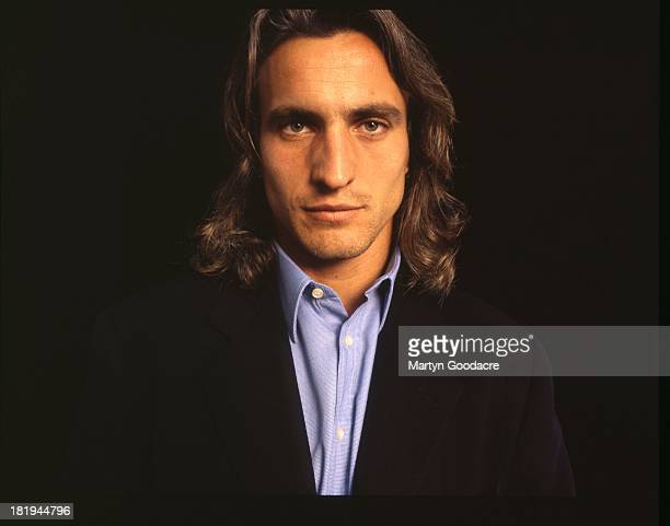David Ginola French footballer poses for a studio portrait London 1998