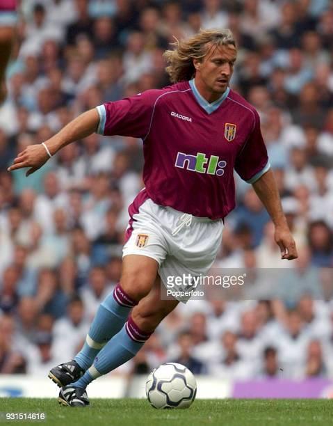 David Ginola of Aston Villa runs with the ball during the FA Barclaycard Premiership match between Tottenham Hotspur and Aston Villa at White Hart...
