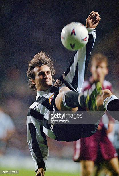 David Ginola of Newcastle in acrobatic action during the UEFA cup 2nd leg tie between Newcastle United and Metz at StJames' Park on December 3 1996...