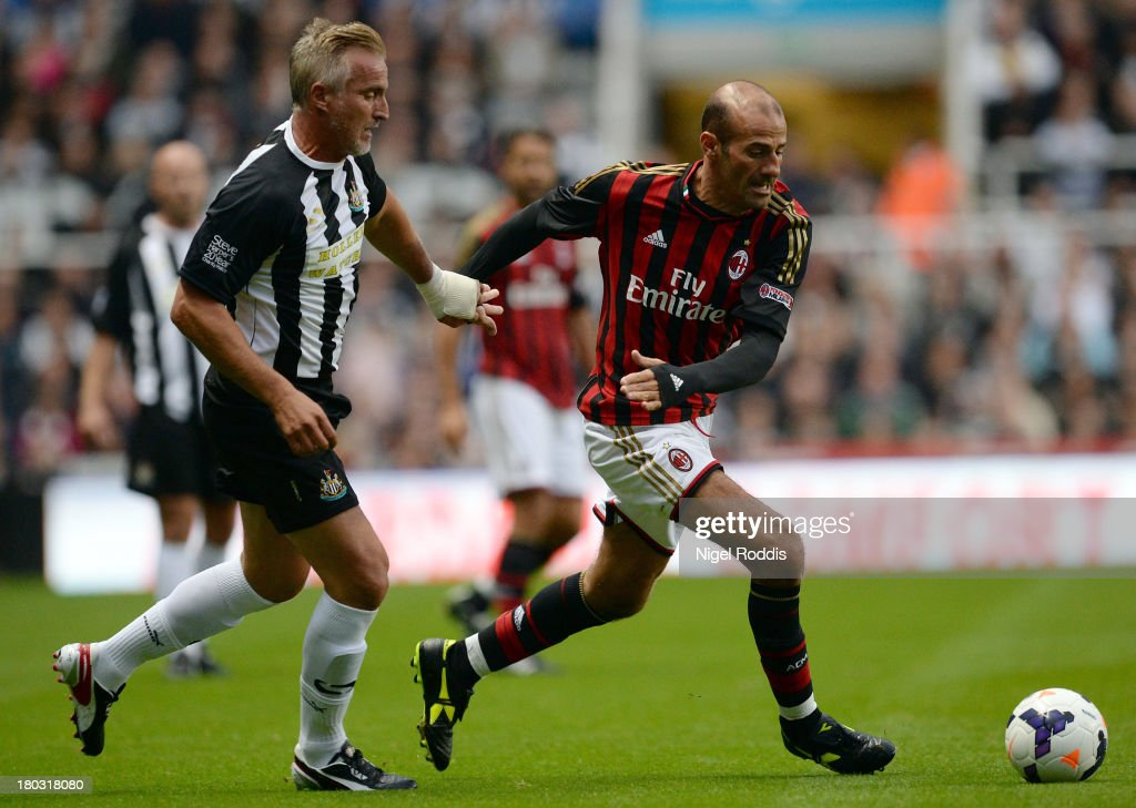 David Ginola (L) of Newcastle United vies for the ball with Gluseppeppe Pancaro (R) of AC Milan Glorie during Steve Harper's testimonial match between Newcastle United and AC Milan Glorie at St James' Park on September 11, 2013 in Newcastle upon Tyne, England.