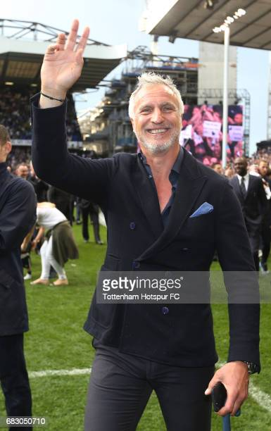 David Ginola waves to the Tottenham Hotspur fans during the closing ceremony after the Premier League match between Tottenham Hotspur and Manchester...