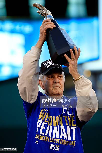 David Glass, Owner and Chief Executive Officer of the Kansas City Royals, hoist the William Harridge Award after their 2 to 1 win over the Baltimore...