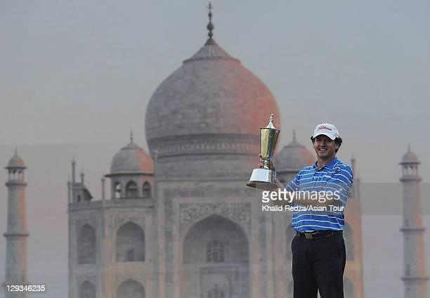 David Gleeson of Australia poses with the Hero Indian Open trophy behind a back drop of the Taj Mahal at Delhi Golf Club on October 16, 2011 in...