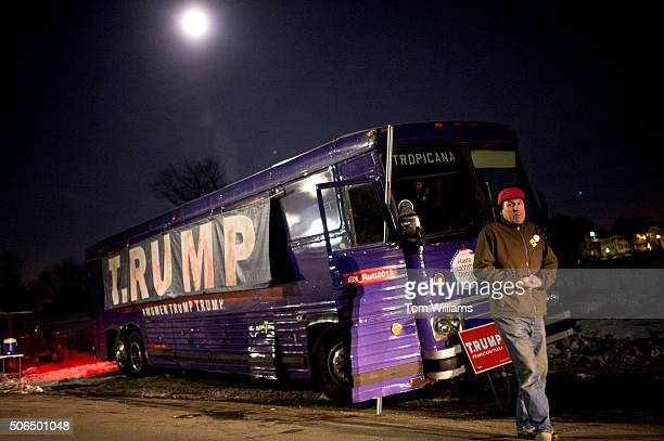 David Gleeson walks by his collaborative art project the TRUMP bus intended to poke fun at Donald Trump outside of a campaign rally for presidential...