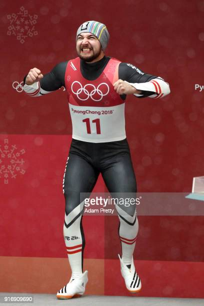 David Gleirscher of Austria celebrates during the flower ceremony after winning the gold medal in the Luge Men's Singles on day two of the...