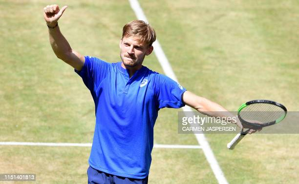 David Goffin from Belgium celebrates his victory over Matteo Berrettini from Italy at the ATP tennis tournament in Halle, western Germany, on June...