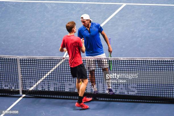 David Goffin of Belgium and Lucas Pouille of France shakes hands during the day 1 of the Final of the Davis Cup match between France and Belgium at...
