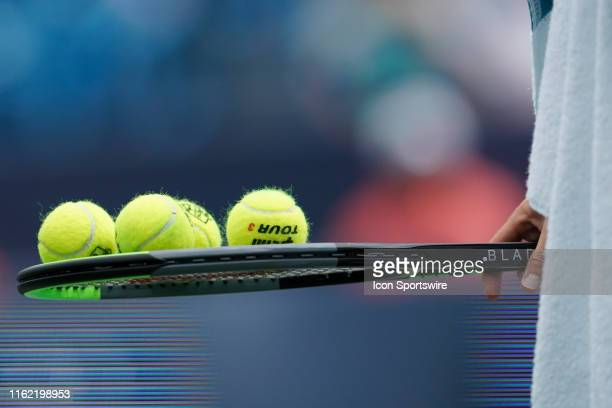 David Goffin of Belgium balances tennis balls on his racket during the semifinal round of the Western & Southern Open at Lindner Family Tennis Center...