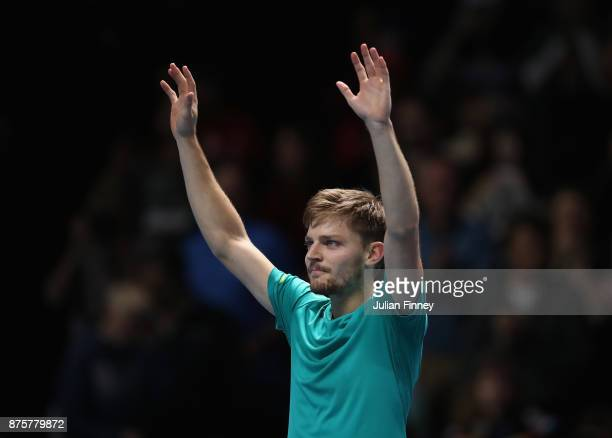 David Goffin of Belgium celebrates defeating Roger Federer of Switzerland in the semi finals during day seven of the Nitto ATP World Tour Finals...