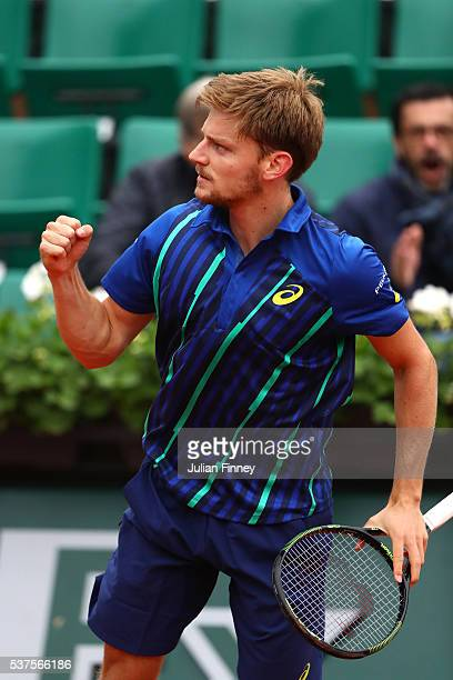 David Goffin of Belgium celebrates set point during the Men's Singles quarter final match against Dominic Thiem of Austria on day twelve of the 2016...