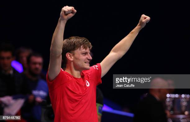 David Goffin of Belgium celebrates winning his match against JoWilfried Tsonga of France during day 3 of the Davis Cup World Group final between...