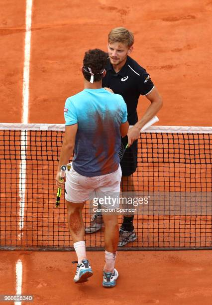David Goffin of Belgium congratulates Marco Cecchinato of Italy on victory following their mens singles fourth round match during day eight of the...