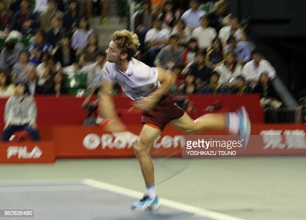 David Goffin of Belgium delivers a service in the final of the Rakuten Japan Open tennis championships in Tokyo on October 9 2016 Kyrgios defeated...