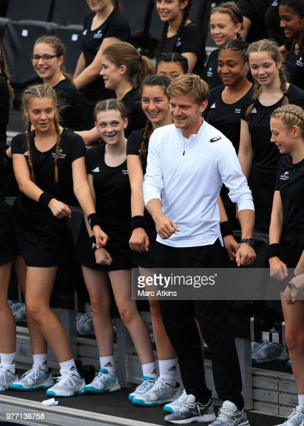David Goffin of Belgium does the floss with a group of ball girls during qualifying Day 2 of the FeverTree Championships at Queens Club on June 17...