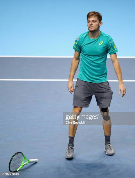 David Goffin of Belgium drops his racket as he celebrates match point after his three set victory against Roger Federer of Switzerland in their semi...