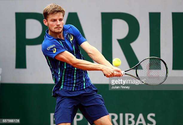 David Goffin of Belgium hits a backhand during the Men's Singles quarter final match against Dominic Thiem of Austria on day twelve of the 2016...