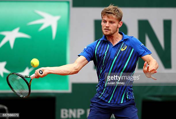 David Goffin of Belgium hits a forehand during the Men's Singles quarter final match against Dominic Thiem of Austria on day twelve of the 2016...