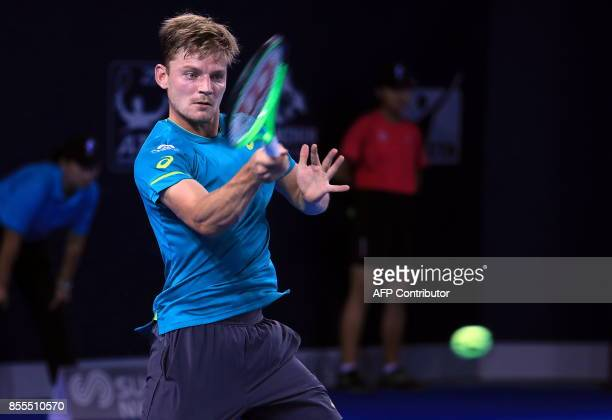 David Goffin of Belgium hits a return against Donald Young of the US during their men's singles quarterfinal match at the ATP Shenzhen Open tennis...