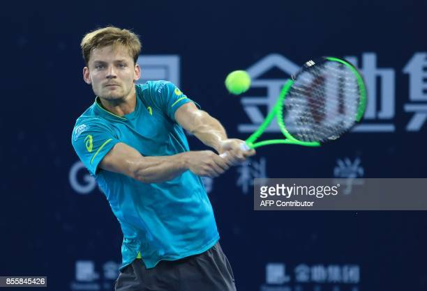 David Goffin of Belgium hits a return against Henri Laaksonen of Switzerland during their men's singles semifinal match at the ATP Shenzhen Open...