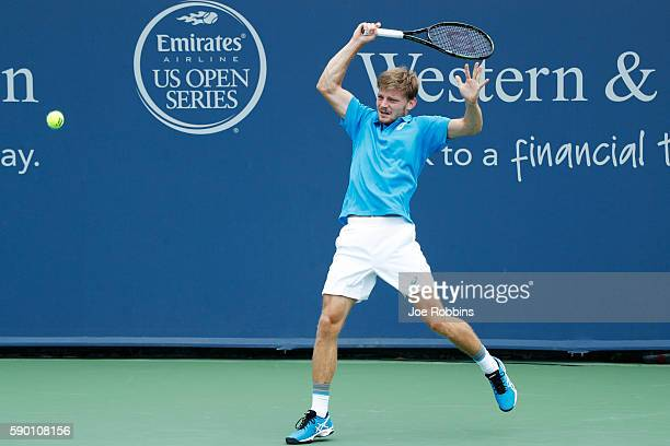 David Goffin of Belgium hits a return to Nikoloz Basilashvili of Georgia during the first round of play on Day 4 of the Western Southern Open at the...