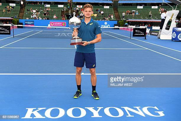 David Goffin of Belgium holds the trophy after winning the men's final against Ivo Karlovic of Croatia at the Kooyong Classic tennis tournament in...
